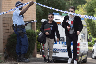 Police remain at a unit complex on Tuesday after a 32-year-old woman was allegedly stabbed by her ex-partner.