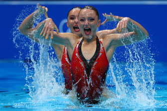 Australians Emily Rogers and Amie Thompson compete in the artistic swimming duet technical routine in Tokyo on Tuesday.
