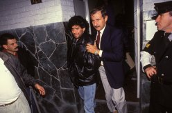 Police arrest Maradona for the use of cocaine in Buenos Aires in 1991.