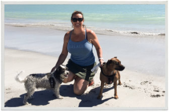 """Gabrielle Targett, pictured here with her dogs Elliot and Tia, stood on a cobbler fish. """"I wouldn't wish it on my worst enemy."""""""