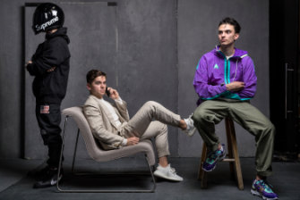 """From left: Nathan Tran wears Nike X Off White Virgil Abloh Blazers sneakers in Grim Reaper black, with Supreme X Simpson Bandit helmet, Supreme X Comme Des Garcons """"Split Box"""" logo hoodie, Supreme X The North Face Goretex pants. Fraser Lack wears Adidas Yeezy Boost 350 sneakers with P Johnson custom-tailored linen suit and Solid Homme silk sweater. Patrick Boyle wears 1of1 ACG Nike React Element 87 sneakers handmade by bespokeIND, with Slow fatigue pants and Nike ACG jacket from Up There store."""