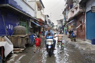 A flooded street in the Muara Baru district of Jakarta back in 2015.