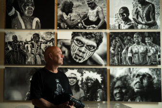 Photographer Wayne Quilliam with his work in the exhibition.