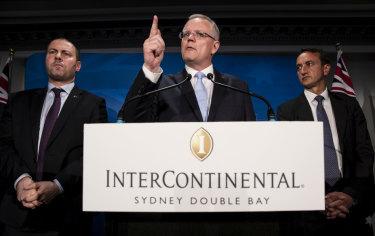 Scott Morrison speaks on Saturday night, flanked by Treasurer Josh Frydenberg and Wentworth candidate Dave Sharma.