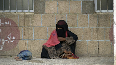 A displaced Yemeni woman and her child fled their home because of the fighting in Hodeida. Here they sit in a school allocated for displaced people in Sanaa, Yemen, in June.