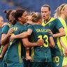 Sam Kerr celebrates with teammates after scoring against Sweden.