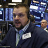 Wall Street closes at record highs on vaccine optimism