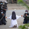 Nun begs Myanmar police to stop but killing continues around her