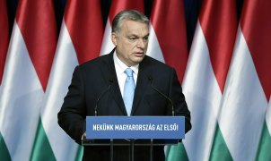 "Hungarian Prime Minister Viktor Orban delivers his annual 'State of Hungary' speech in Budapest on Sunday. The inscription on the podium reads: ""For us Hungary is the first!"""