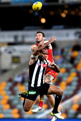 Collingwood's Travis Varcoe is spoiled by Jarrod Harbrow of the Suns.