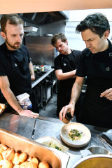 Ben Shewry, right, working on new recipes in the kitchen at Attica.