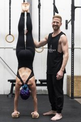 Professional acrobat Brendan Irving supports Jade Twist during a handstand.