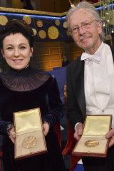 Literature laureates Olga Tokarczuk and Peter Handke pose with their Nobel medals at the Nobel Prize award ceremony.