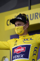 Mathieu Van Der Poel in the overall leader's yellow jersey.
