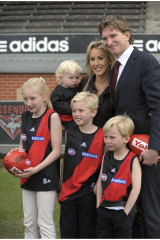 James Hird and wife Tania with their children, including Tom (centre) in 2010, when James was appointed coach of Essendon.