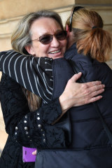Jenny Hallam is seen with a supporter outside the District Court of SA on Thursday.