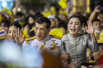 King Maha Vajiralongkorn, considered the world's richest monarch, and Queen Suthida greet supporters of the Thai monarchy on November 1.