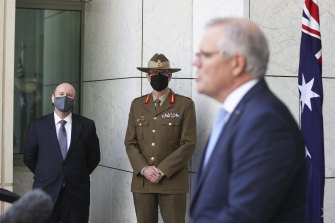 Secretary of the Department of Defence Greg Moriarty, Chief of the Defence Force General Angus Campbell and Prime Minister Scott Morrison announce the new subs deal.