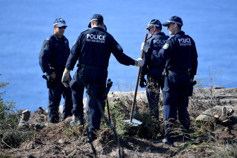 Police undertake a search at North Head near Manly.