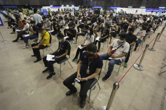 People in Bangkok wait after receiving China's Sinovac vaccine.