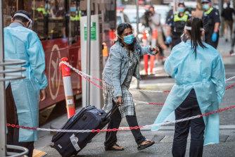 International return travellers arriving at hotel quarantine in Melbourne.