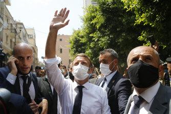 French President Emmanuel Macron walks through Beirut on Thursday.