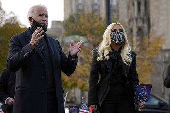 Joe Biden stands with Lady Gaga at a rally just before election day.