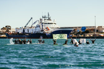 A group of environmental activists paddle out into Corio Bay to protest a seismic testing ship en route to Otway Basin off King Island.