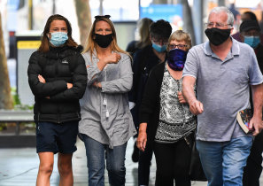A common sight: People wear masks on the street in Melbourne.