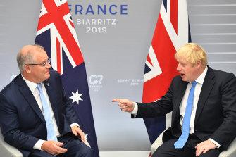 Scott Morrison and Boris Johnson talk trade in France, August 2019.