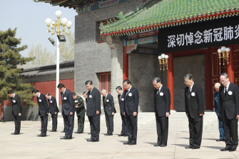 Chinese President Xi Jinping, fourth from left in front row, with other Chinese leaders during national mourning for victims of coronavirus at the Zhongnanhai Leadership Compound in Beijing on Saturday, April 4.