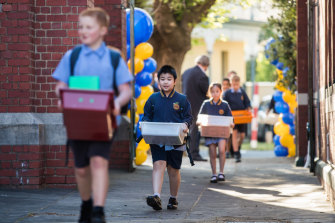 Students at St Brendan's Primary School in Flemington return to school on Monday.