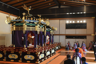 Naruhito, left, delivers his speech as Masako, second from left, Prime Minister Shinzo Abe, right, and other officials attend the enthronement ceremony.