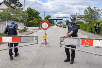 Border guards open the border crossing in Thonex, near Geneva in Switzerland, on Sunday.
