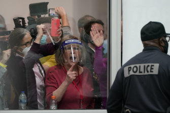 Election challengers yell at workers inside the central counting board in Detroit.