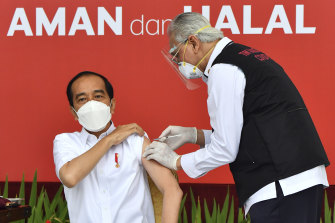 President Joko Widodo receives the first approved CoronaVac shot in Indonesia in January.