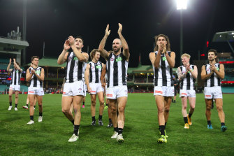 Collingwood celebrate their win over Melbourne at the SCG.