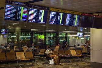 Travellers waits at Changi Airport in Singapore.