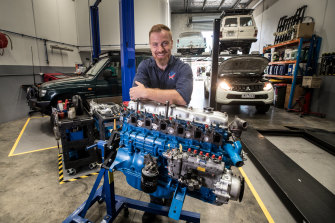 Mechanic Richard Brown is booked out for weeks because of the unprecedented run on used cars.