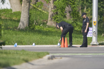 'An act of mass murder': police investigate the scene.
