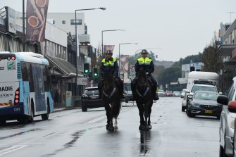 NSW Mounted Police patrol the streets of Fairfield in Sydney's south west during the city's COVID-19 lockdown.