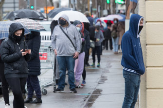 People line up to get a COVID test in Collingwood on Tuesday.