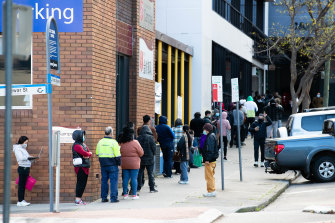 """People line up around the block for Centrelink in Campsie, in south-west Sydney. Google searches for the word """"Centrelink"""" have soared since the start of the Sydney lockdown."""