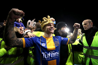 Jason Cummings celebrates after his two goals for Shrewsbury Town earned an FA Cup replay against Liverpool.