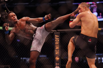 Israel Adesanya (left) was too strong for his Australian rival, Robert Whittaker.