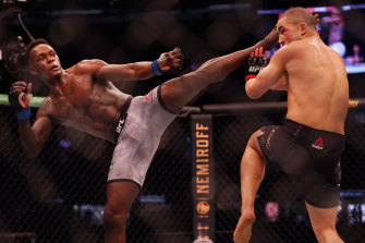 Israel Adesanya (left) was too strong for his Australian rival.