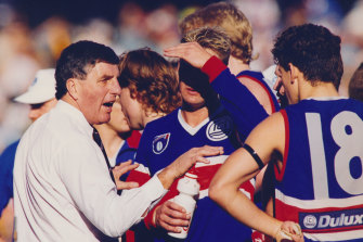 The coach's word is gospel as Footscray players listen intently.