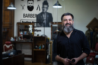 Open for business: Michael Mawa at Blackstone Barbers on Friday.
