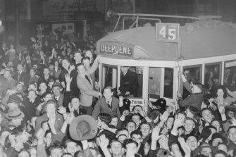 A crowd celebrates Japan's surrender on a tram in Melbourne, 1945.