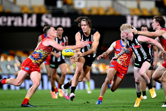 Magpies defender Darcy Moore under pressure.